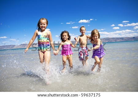 Ethnically diverse Children Playing at the Beach - stock photo