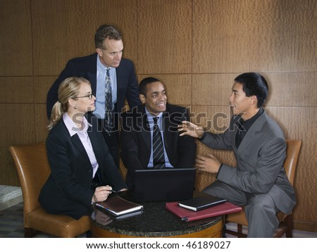 Ethnically diverse group of businessmen and a businesswoman having an enjoyable meeting together. Horizontal shot. - stock photo