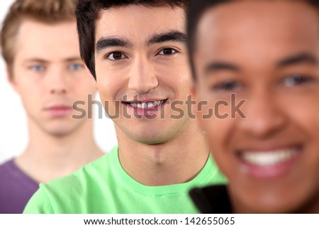 Ethnically diverse group of young men - stock photo