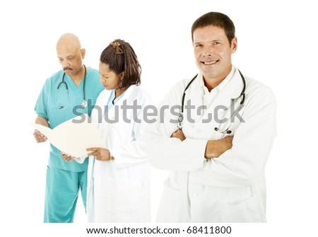 Ethnically diverse medical team.  Isolated on white.