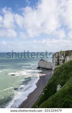 Etretat cliff, rocks and natural arch landmark and blue ocean.Normandy, France, Europe.
