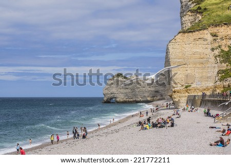 ETRETAT, FRANCE - JULY 18, 2012: Panoramic views of famous village d'Etretat - commune in Seine-Maritime department in Haute-Normandie region. Etretat is now a famous French seaside resort.