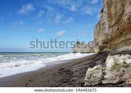 Etretat, natural rock arch wonder, cliff and beach. Normandy, France.