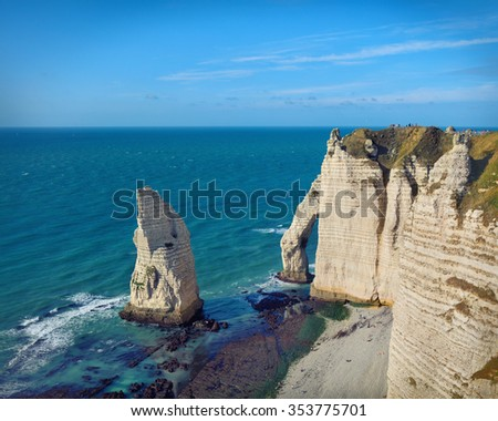 Etretat steep arch shaped cliff at low tide, view from above, Normandy, France - stock photo