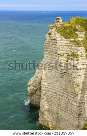 Etretat - turquoise sea and alabaster cliff! Etretat is a commune in the Seine-Maritime department in the Haute-Normandie region in northwestern France. Etretat is now a famous French seaside resort. - stock photo