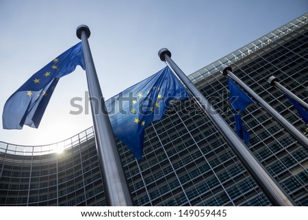 EU Commission building Europe Flags in Brussels - stock photo