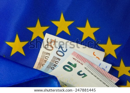 EU flag and Euro notes - stock photo