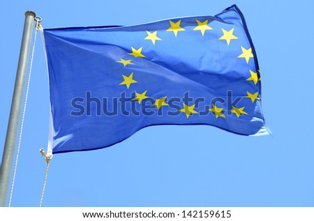 EU flag on a background of blue sky