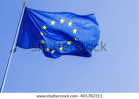EU flag on a background of blue sky - stock photo