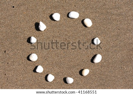 EU flag on sand made from stones