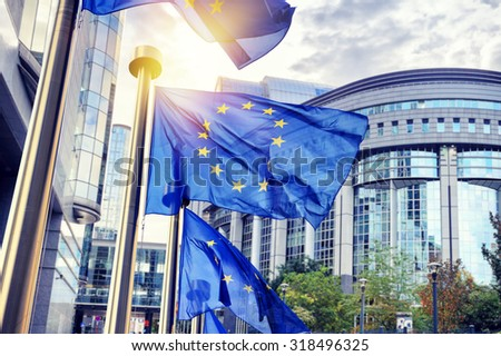 EU flags waving in front of European Parliament building. Brussels, Belgium - stock photo