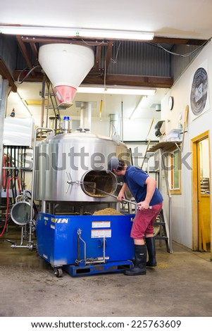 EUGENE, OR - JULY 17, 2014: Brewer at Oakshire Brewing making large quantities of Watershed IPA, a staple beer for this craft brewery. - stock photo