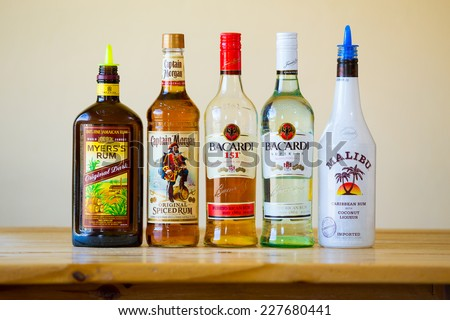 EUGENE, OR - JUNE 23, 2014: Rum selection at a bar showing five kinds of hard liquor. - stock photo