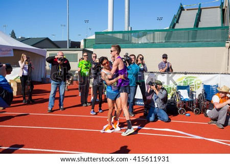 EUGENE, OR - MAY 1, 2016: Carlos Trujillo wins first place overall in the full marathon with a time of 2:18:54, qualifying him for the 2016 Olympic Trials, at the 2016 Eugene Marathon.