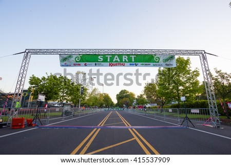 EUGENE, OR - MAY 1, 2016: Pre-race starting line at the 2016 Eugene Marathon, a Boston qualifying event. - stock photo