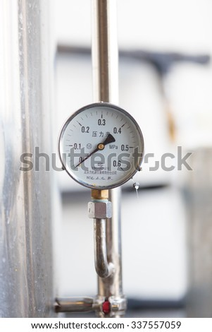 EUGENE, OR - NOVEMBER 4, 2015: Pressure valve on a fermenter at the startup craft brewery Mancave Brewing.