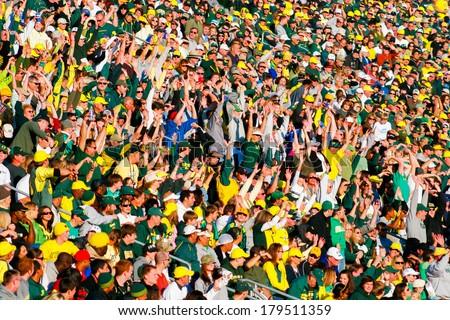 EUGENE, OR - OCTOBER 28, 2006: Autzen Stadium crowd does the wave while cheering on the Oregon Ducks during the UO vs PSU football game. - stock photo