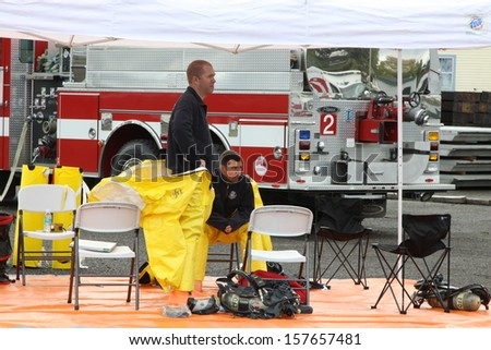 EUGENE, OREGON, USA November 3, 2011: Eugene Fire departments & emergency teams conduct disaster drills. This HAZMAT team is waiting with PPE to protect them from hazardous materials. - stock photo