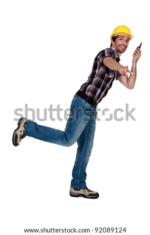 Euphoric traffic controller standing on one foot and using a walkie-talkie - stock photo