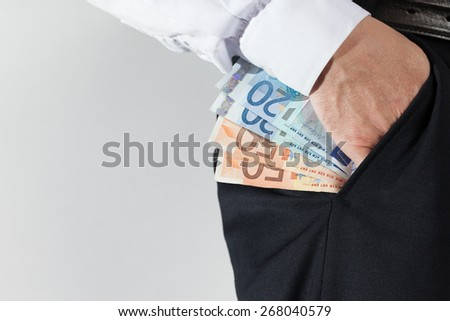 EUR in the pocket - stock photo