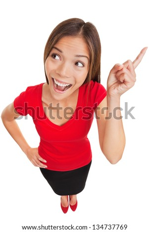 Eureka. Beautiful intelligent woman with a bright idea or mental breakthrough raising her finger in the air while looking up with an eager expression, fun high angle full body studio portrait on white - stock photo