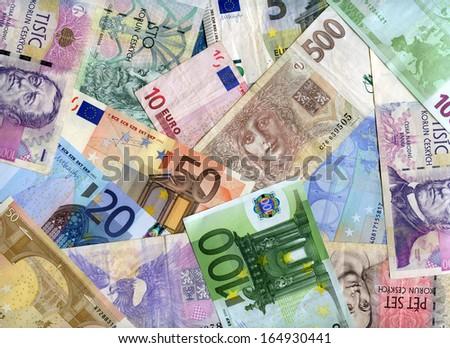 Euro and Czech banknotes (korunas) background - stock photo