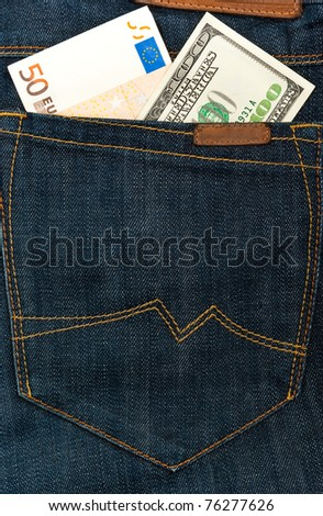 Euro and dollar banknotes in jeans hip pocket