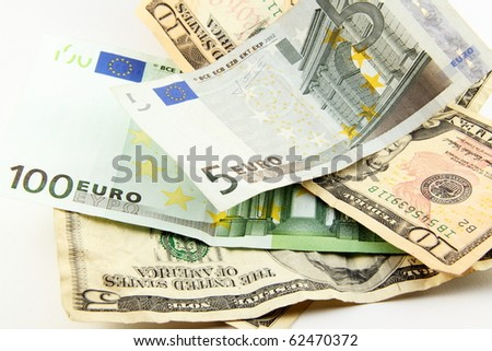 Euro and dollar bills isolated on white - stock photo