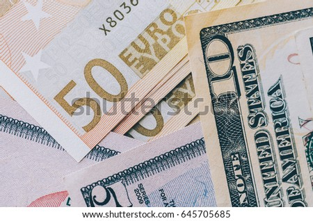 Euro and dollars banknotes on the table