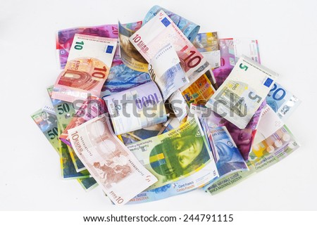euro and Swiss franc - stock photo