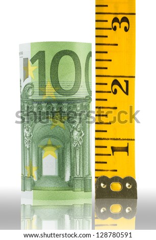 Euro bank note and tape measure - stock photo