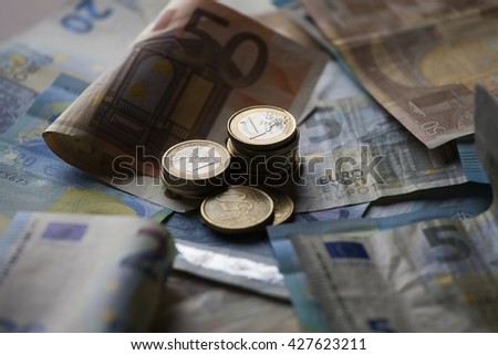 Euro bank notes and money coins - stock photo