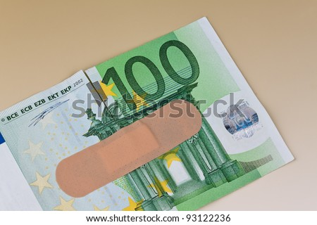 euro bank notes with a sticking plaster. debt and budget - stock photo