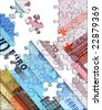 Euro bank notes with jigsaw puzzle cutout - stock photo