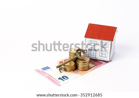 Euro banknote and coins stack with key and paper house for mortgage loans concept