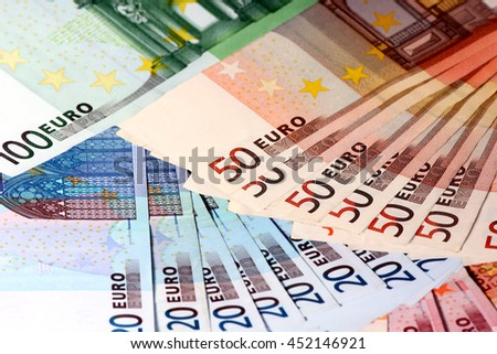 Euro banknote paper as part of the economic and trading system - stock photo