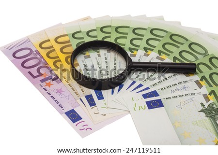 Euro banknote under magnifying glass - stock photo