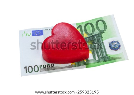 Euro banknotes and a red heart made of one hundred euro bill - stock photo