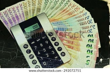 Euro banknotes and calculator - stock photo