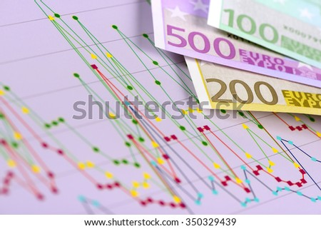 Euro banknotes and chart show success at finance and stock market - stock photo