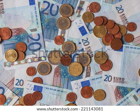 Euro banknotes and coins (EUR) - currency of the European Union - stock photo