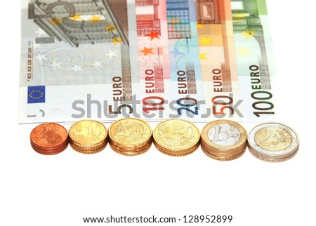 Euro banknotes and coins isolated on white background - stock photo