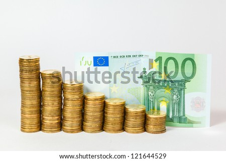 euro banknotes and coins on white background - stock photo