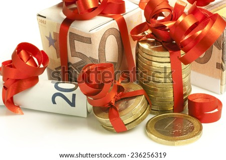 euro banknotes and coins wrapped as a gift - stock photo