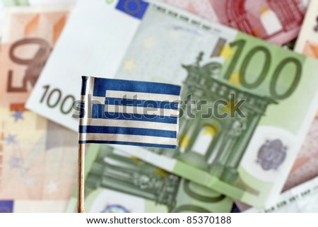 Euro banknotes and Greek flag, Greece Defaults - stock photo