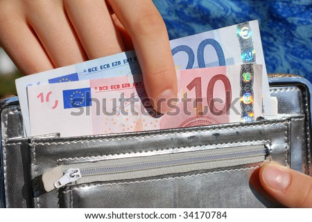 Euro banknotes and purse - stock photo