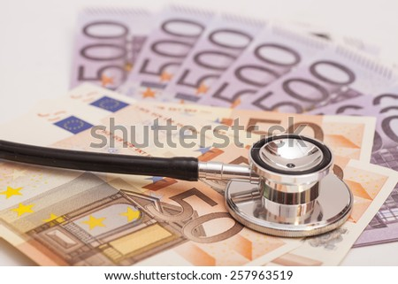 Euro banknotes and stethoscope - stock photo