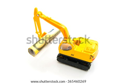 euro banknotes and yellow backhoe on white