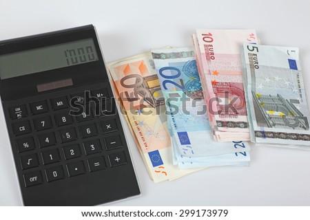Euro banknotes, calculator, 1000 Euro - stock photo