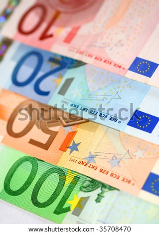 Euro banknotes, close-up with shallow depth-of-field; focus on the 100 Euro banknote